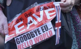 A vote leave supporter holds a poster in Westminster, London, Britain June 24, 2016.       REUTERS/Toby Melville